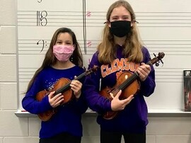 Two students with violins