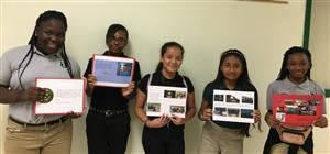 photo of students with their cards