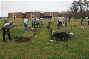 photo of volunteers working on the back field