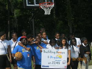 photo of students with new basketball hoop