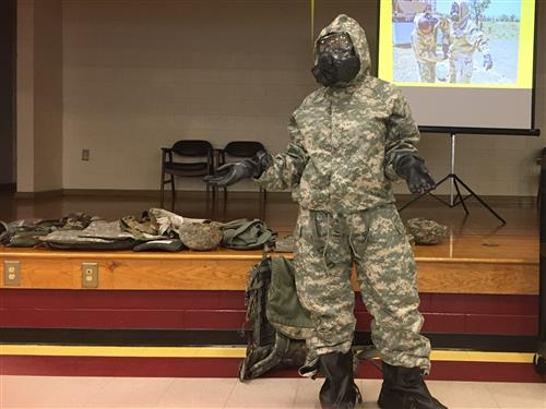 Veteran wearing chemical protection suit