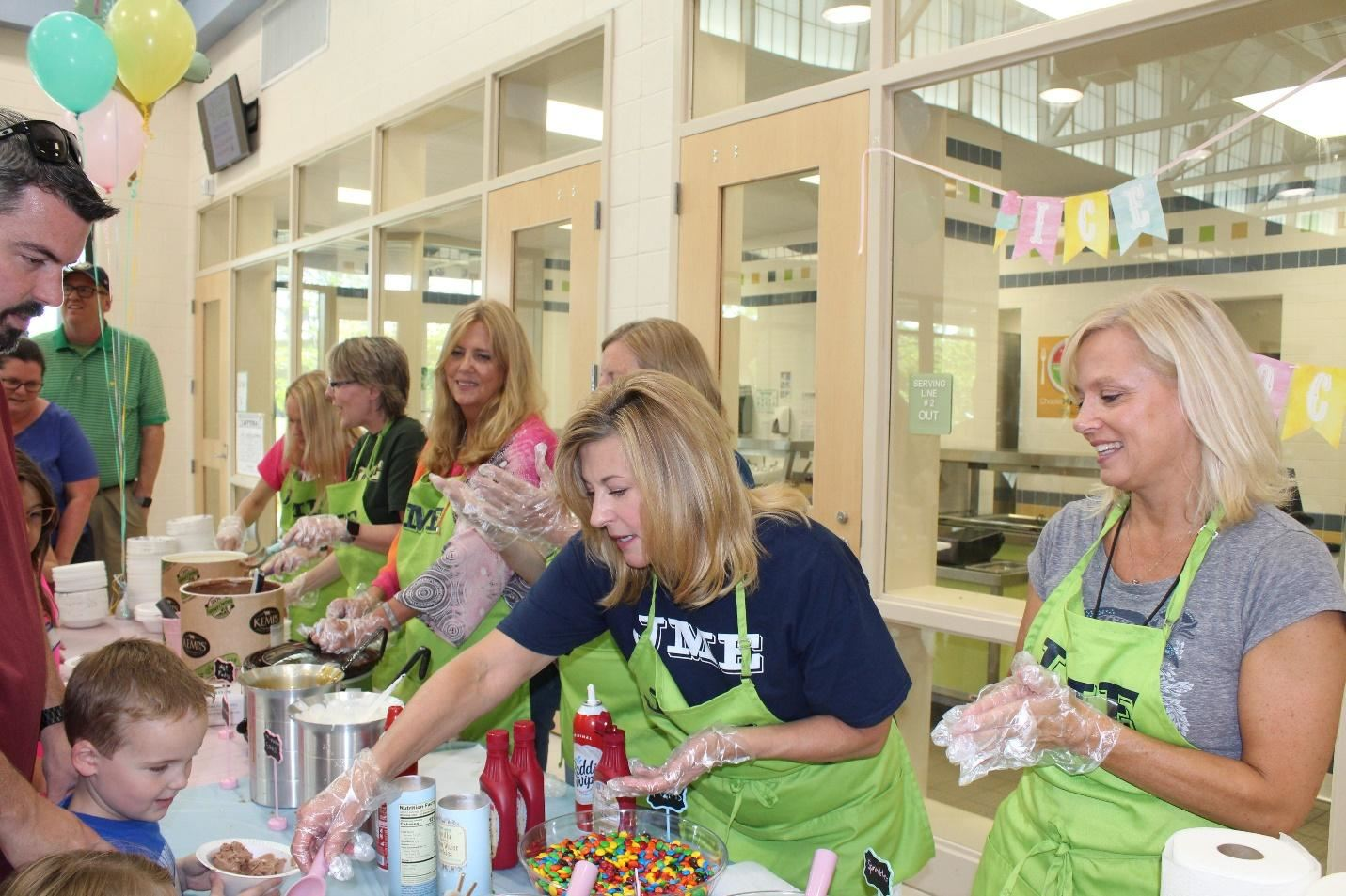 Teachers served ice cream and toppings during Jennie Moore's annual ice cream social!