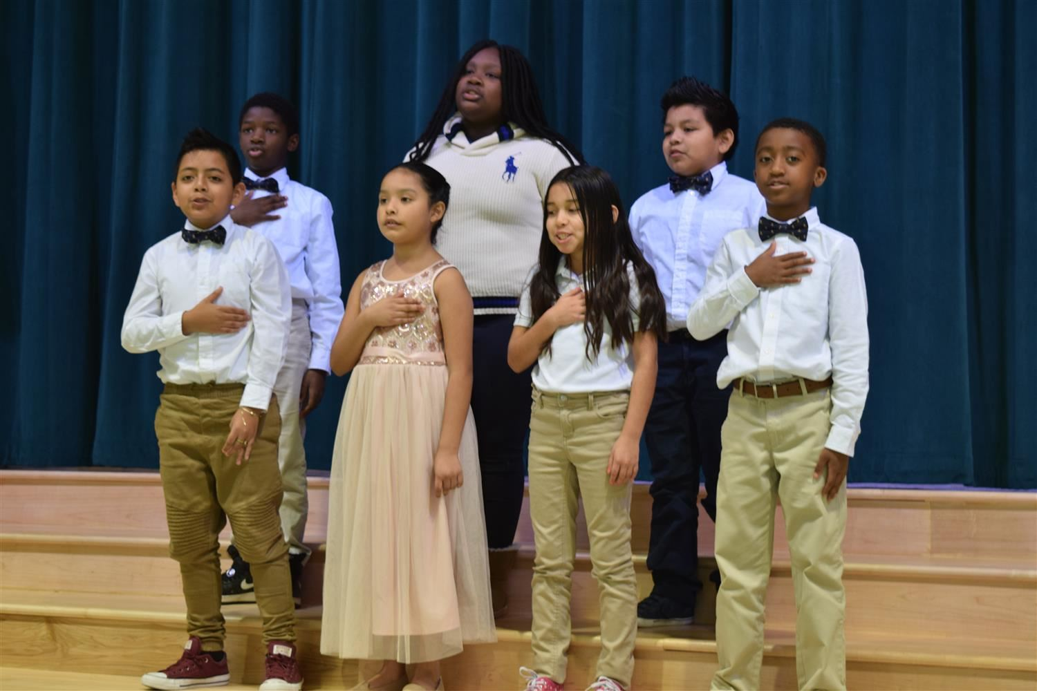 Dunston students lead guests in the pledge