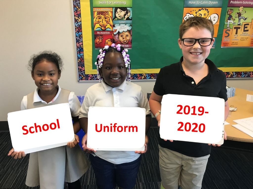 Kids with school uniform signs