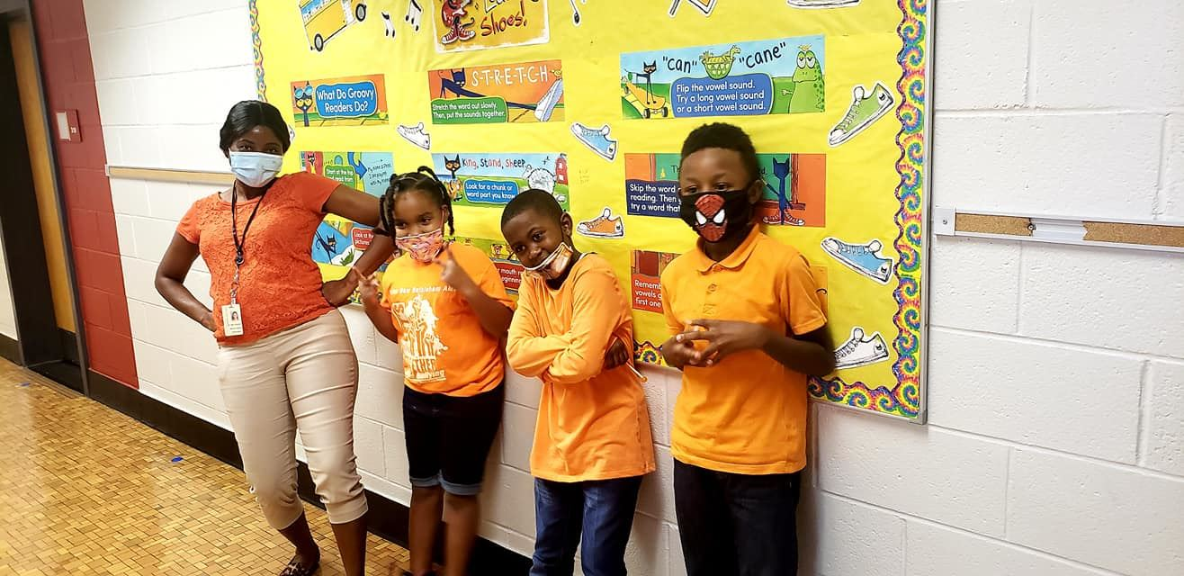 Students pose in their orange shirts as part of Unity Day