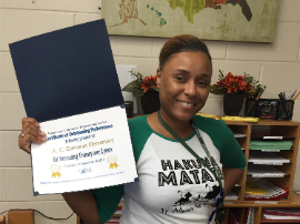 Mrs. Sumter holding her award for bringing down truancy