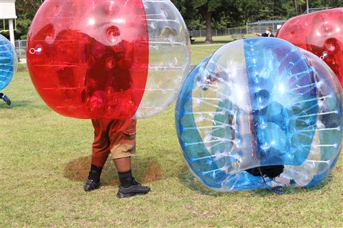 students roll in human hamster balls