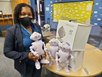 Latoya Bennet displays the schools new Abii robots