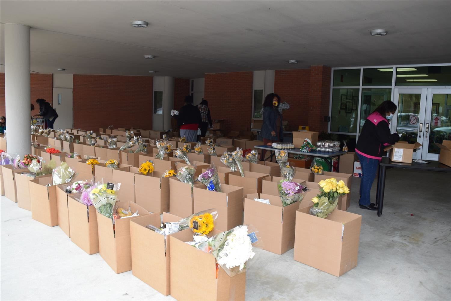 boxes of food are prepared for distribution